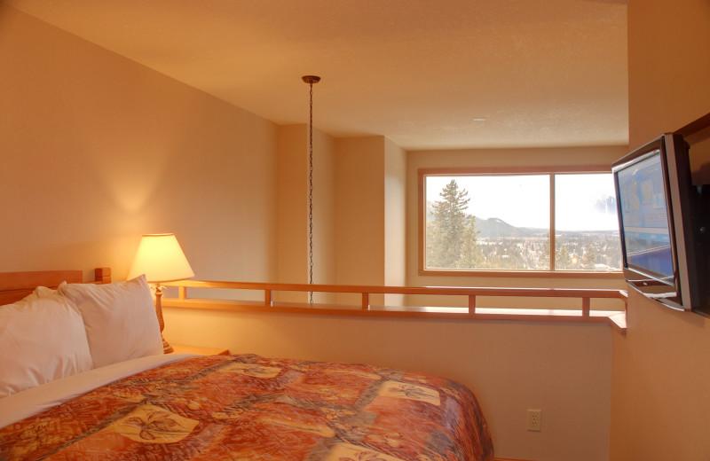 Guest bed at Hidden Ridge Resort.