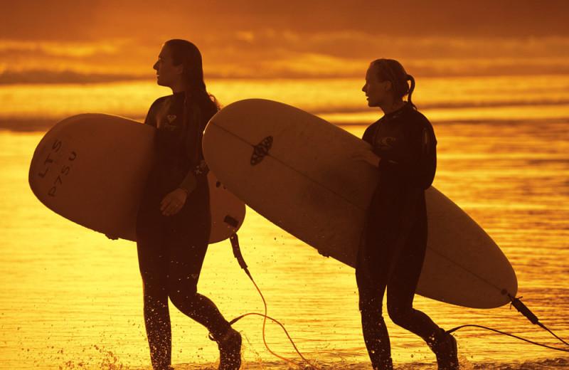 Surfing on the beach at Cox Bay Beach Resort.