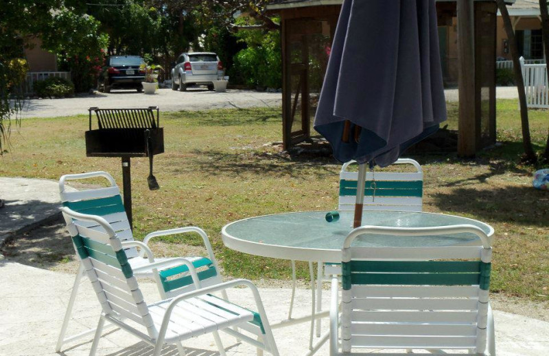 Lawn chairs with grill at Coral Bay Resort.