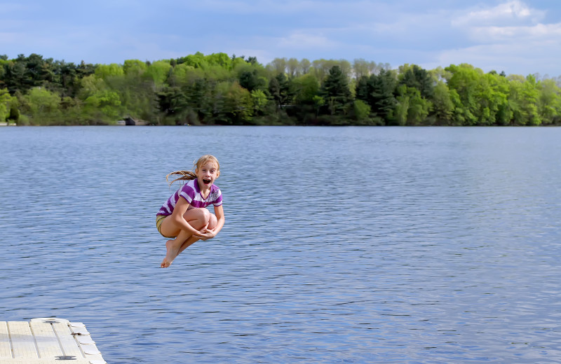 Jumping in lake at Red School Resort.