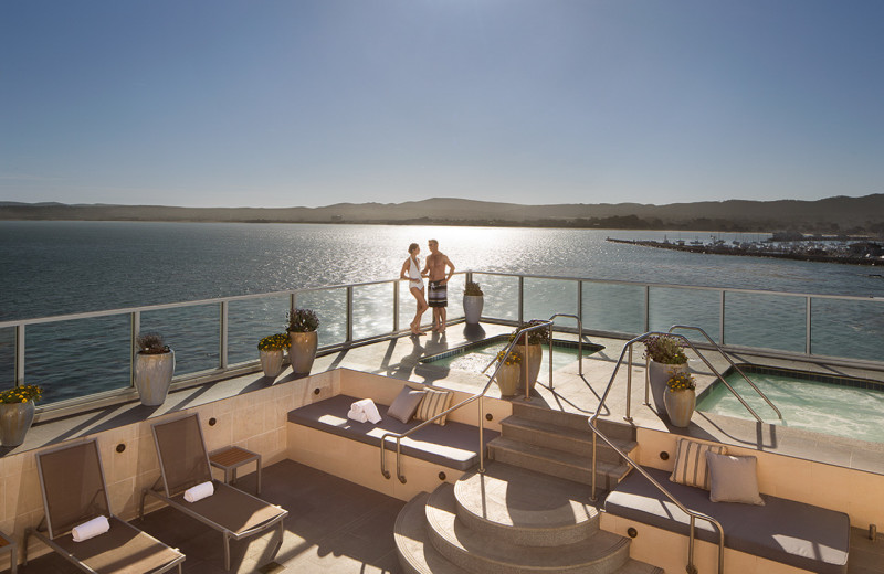 Couple enjoying the Penthouse Level sundeck and hot tubs at Vista Blue Spa.