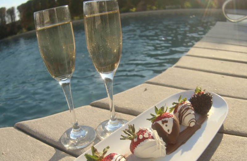 Wine and chocolate strawberries by the pool at A Victorian On The Bay.