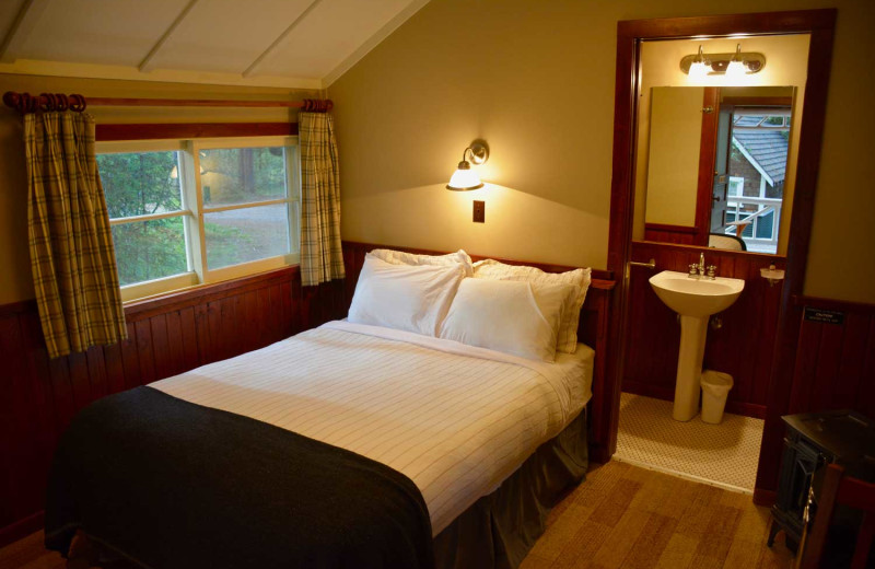 Cabin bedroom at Johnston Canyon Lodge & Bungalows.