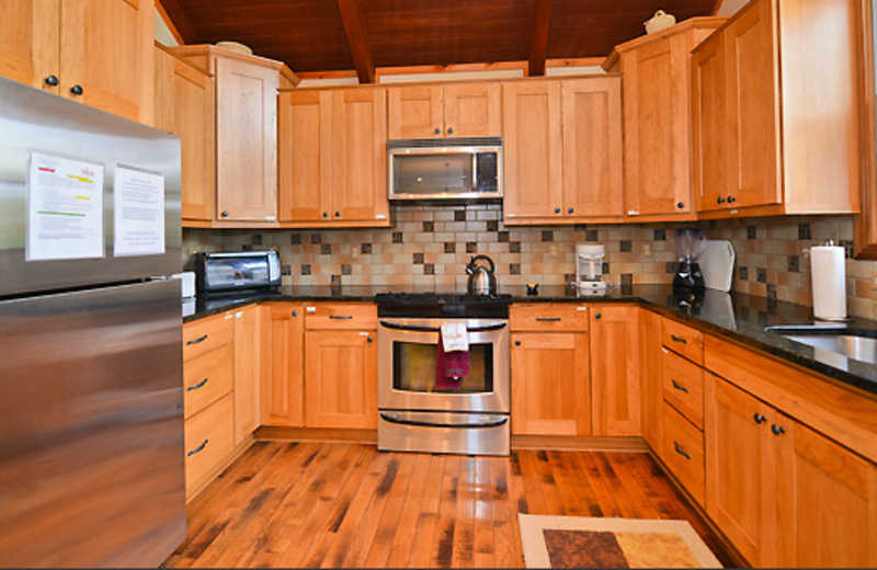 Cabin kitchen at Black Bear Resort Rentals.