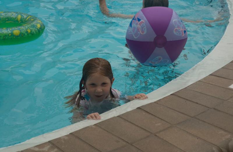 Kids playing in pool at Nautilus Condominiums.