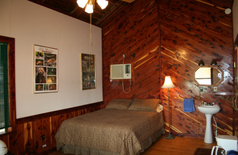 Cabin bedroom at The Exotic Resort Zoo