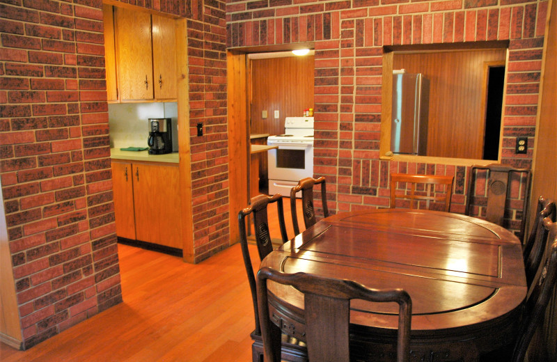 Cabin 15 Alder kitchen and dining at Gwin's Lodge & Kenai Peninsula Charter Booking Service.