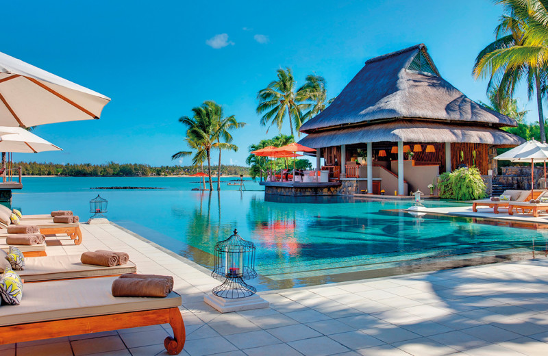 Outdoor pool at Belle Mare Plage Golf Hotel & Resort.