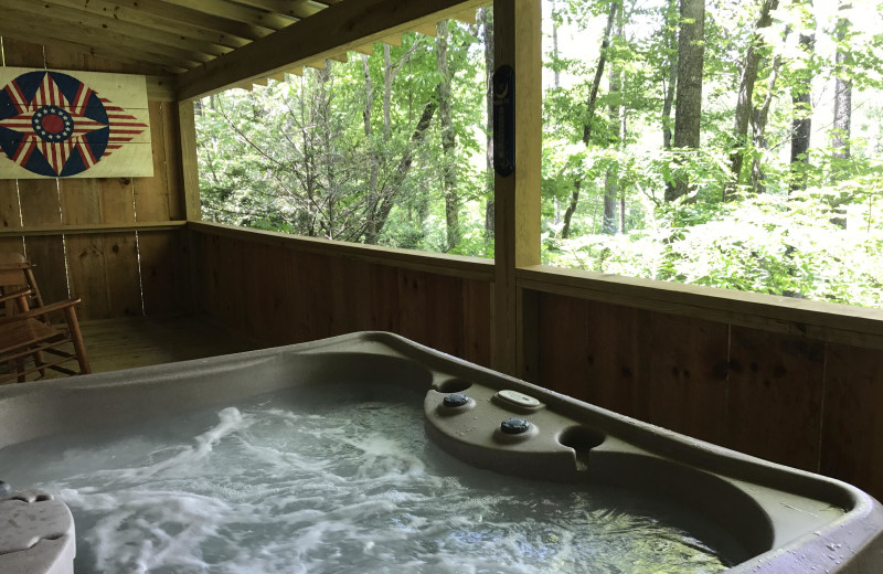 Cabin hot tub at Cabins of Asheville.