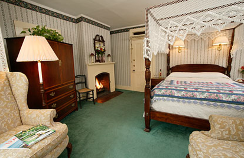 Fireplace bedroom at The Village Inn.