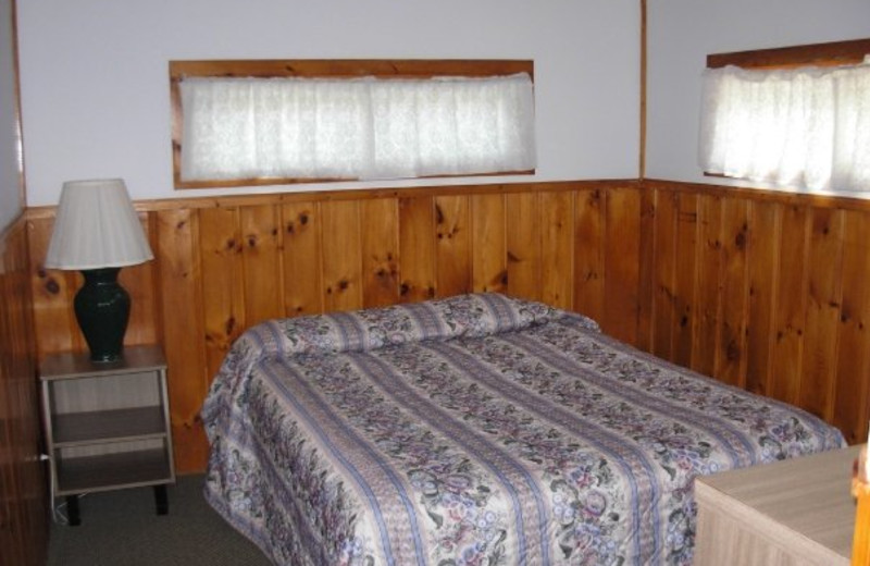 Cottage bedroom at Diamond Cove Cottages.