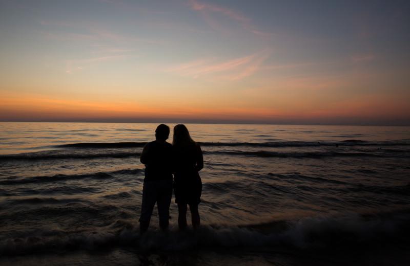 Couple on beach at Wisteria Inn.