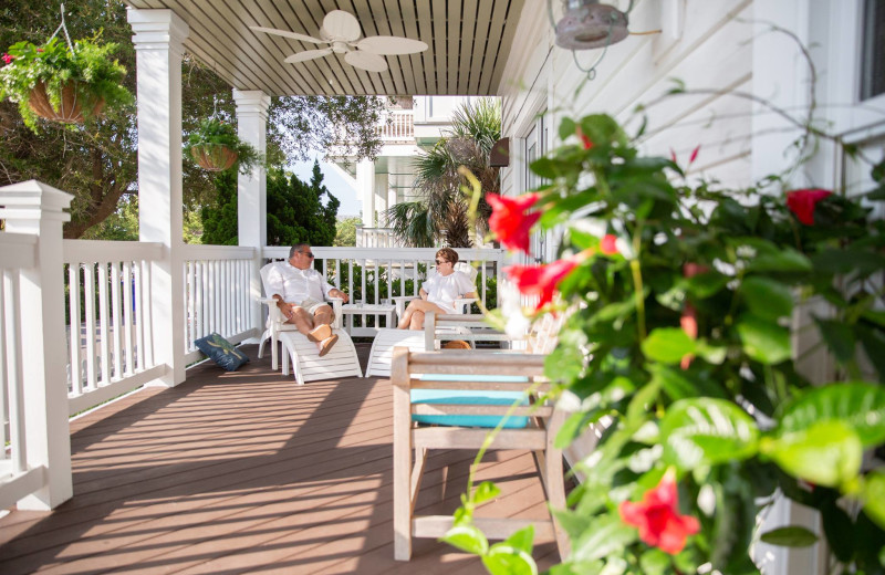 Couple on porch at The Inn at Bald Head Island.