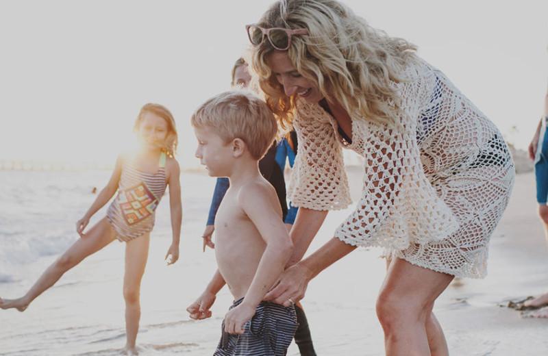 Family on beach at Anchorage Inn.