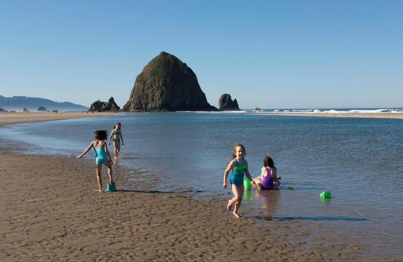Family on the beach at Hallmark Resort in Cannon Beach.