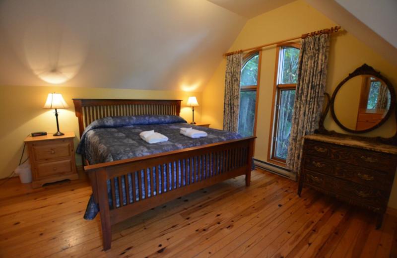 Cottage bedroom at Port Cunnington Lodge & Resort.