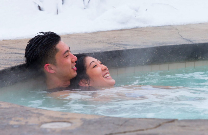 Couple in hot tub at Superior Shores Resort.