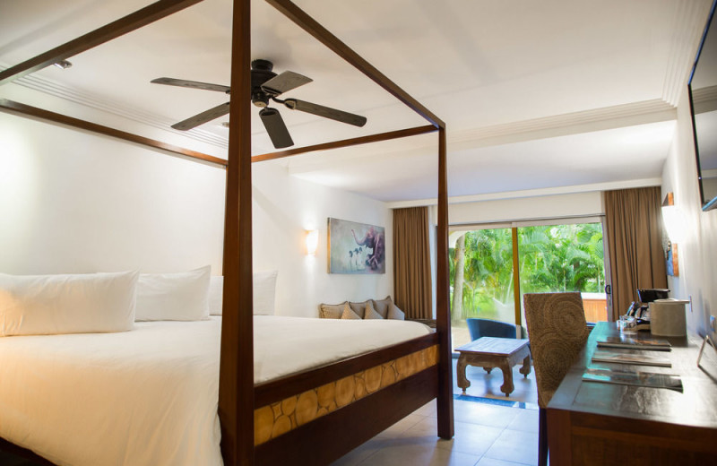 Guest room at Sandos Playacar Beach Resort.