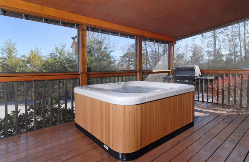 Deck jacuzzi at Fireside Chalets & Cabin Rentals.