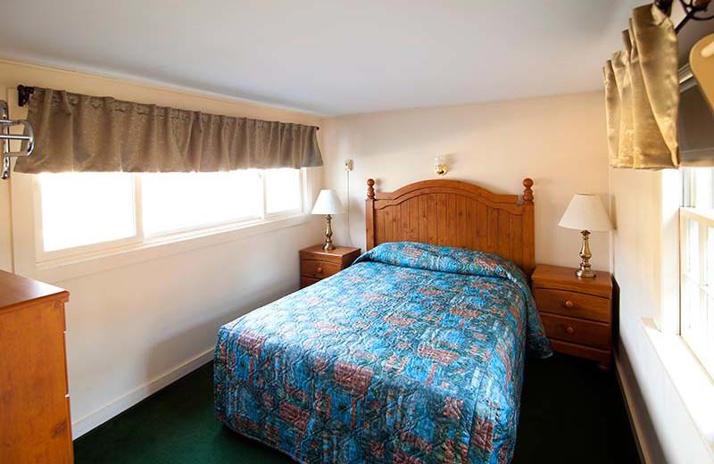 Cabin bedroom at Riverbank Motel & Cabins.