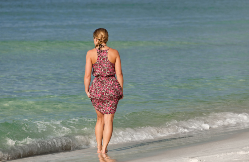 Person walking on beach at The Islander in Destin.