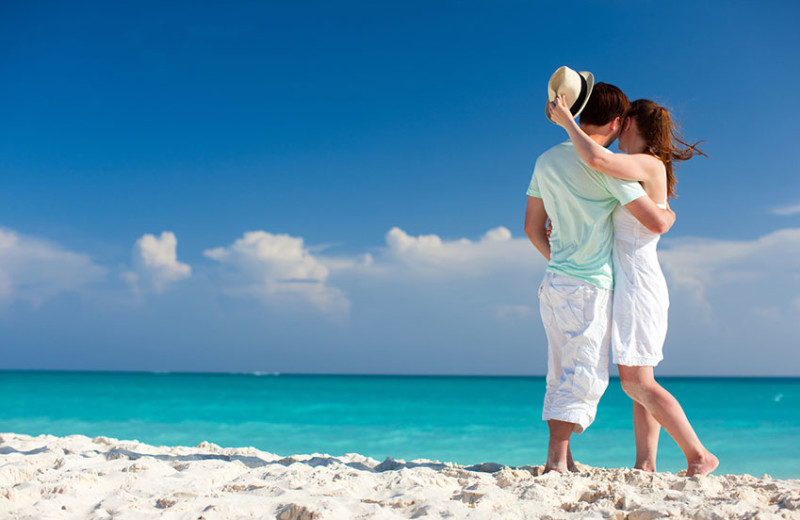 Couple on beach at Bric Vacation Rentals.