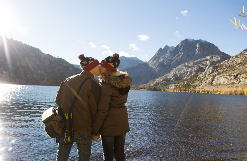 Couple by lake at Nomadness Rentals.