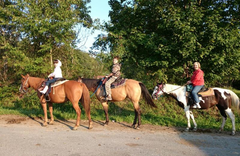 Horseback riding at Country Road Cabins.