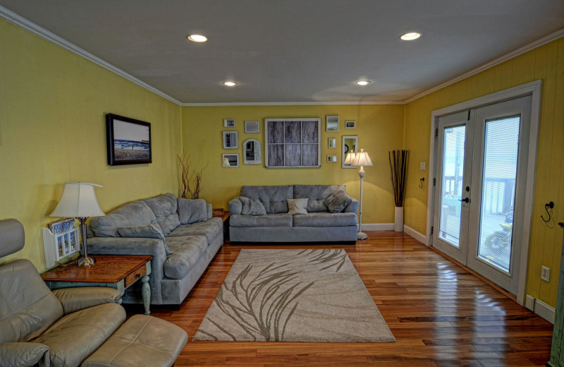 Vacation rental living room at Century 21 Action Inc.
