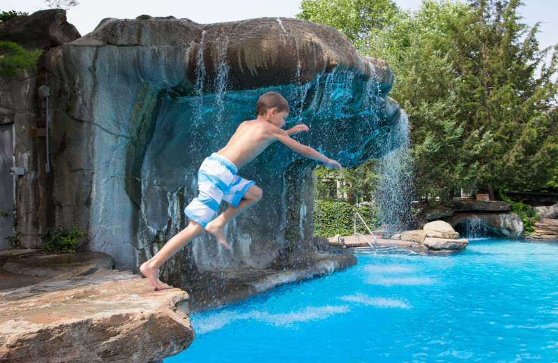 Jumping in the pool at Crystal Springs Resort.