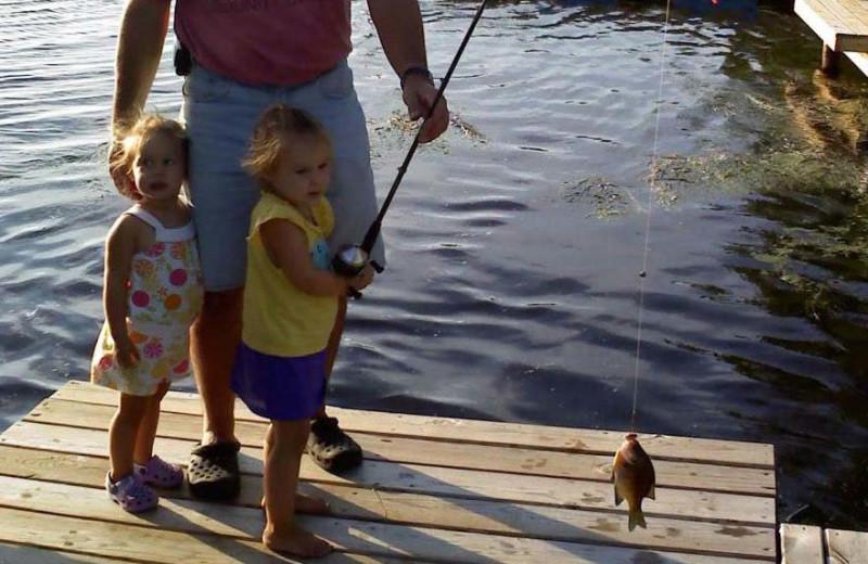 Family fishing at Ward's Riverside Cabins.
