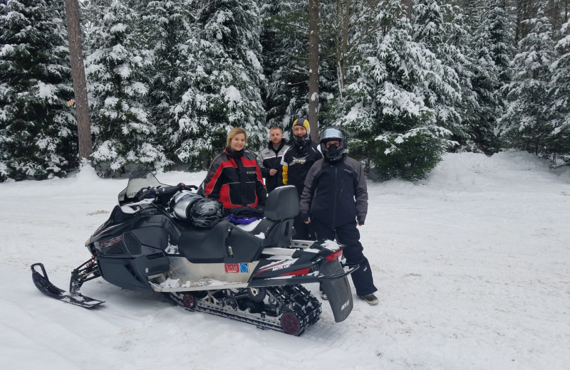 Snowmobiling at Hiller Vacation Homes.