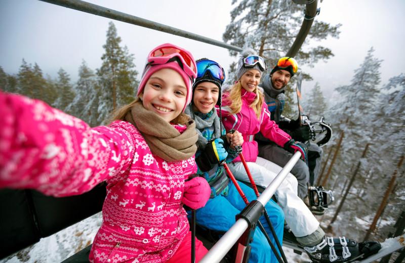 Family skiing at Canyon Services Vacation Rentals.