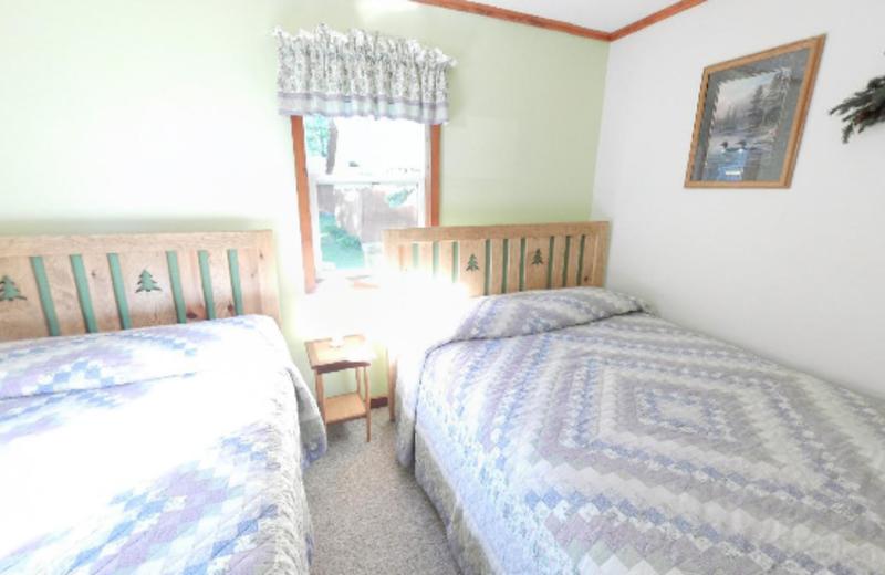 Cabin Bedroom at Janetski's Big Chetac Resort
