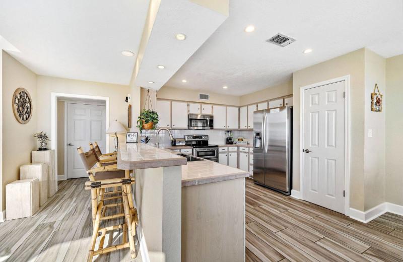 Rental kitchen at Gary Greene Vacation Rentals.