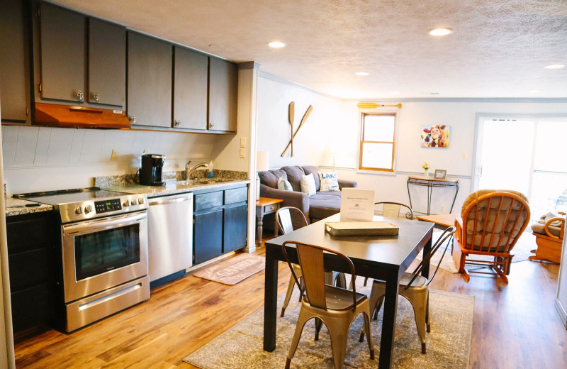Rental kitchen and living room at Amazing Branson Cabin Rentals - RentBranson.