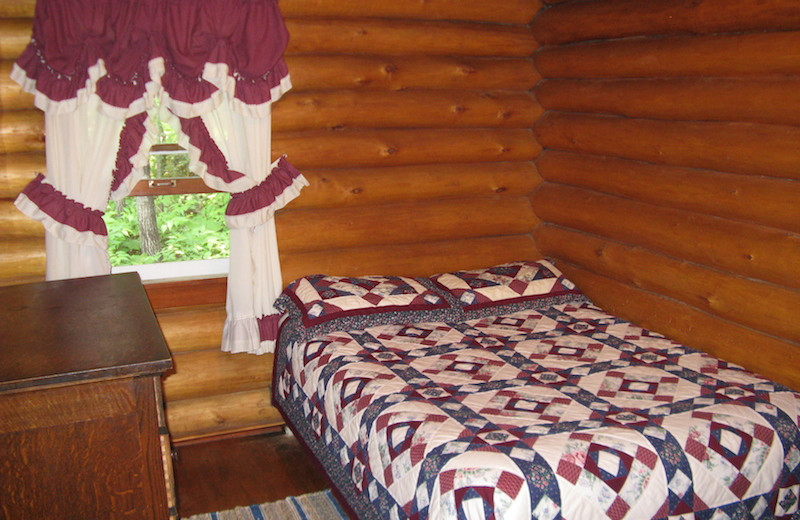 Cabin bedroom at Herseth's Tomahawk Resort.