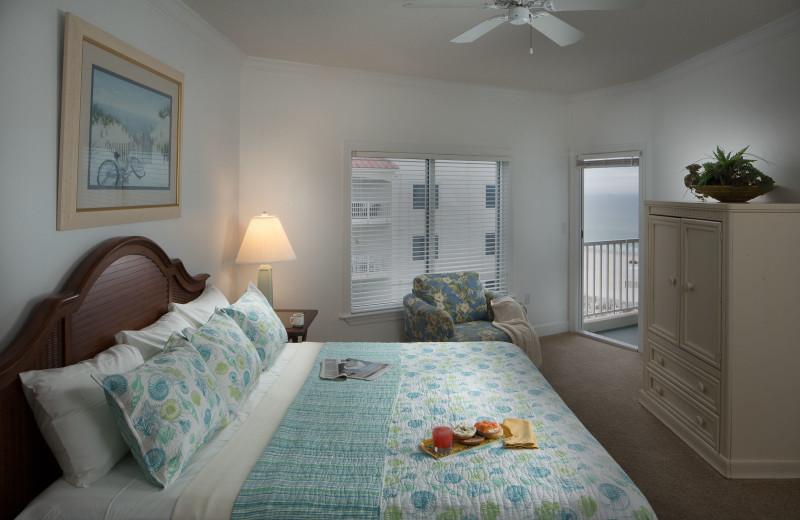Guest bedroom at Palm Beach Resort Orange Beach.