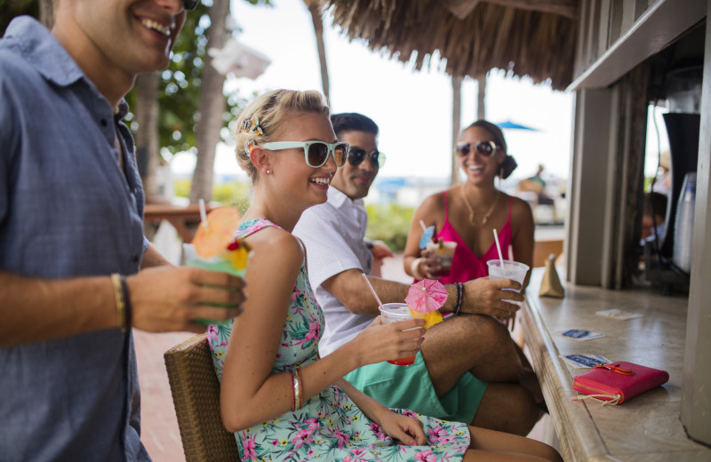 Grab a drink at the beachside bar at TradeWinds Island Grand.