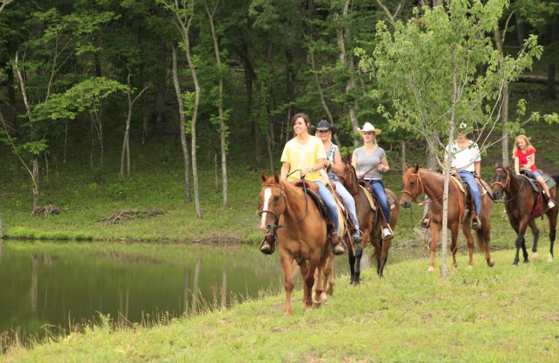 Horseback riding along shore line at Morrell Ranch.
