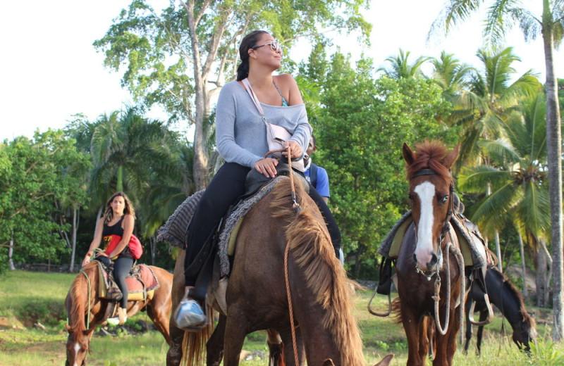 Horseback riding at Villa Serena Hotel.