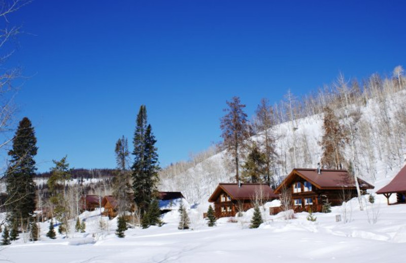 Cabins covered in snow at Vista Verde Ranch.