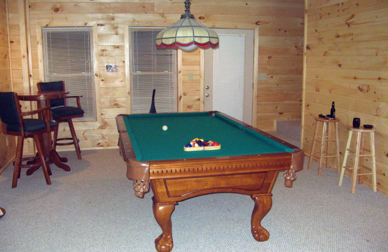 Cabin billiards table at Black Bear Cabin Rentals.