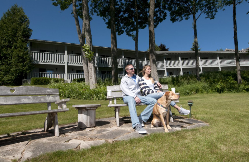 Couple sitting on bench outside Country House Resort.