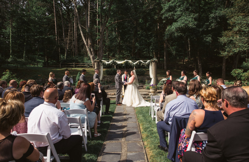 Wedding ceremony at Arrow Park Lake and Lodge.