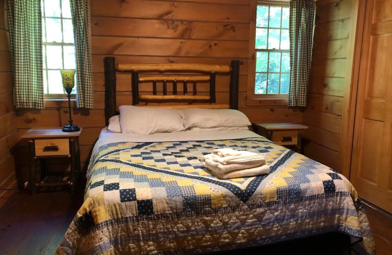 Cabin bedroom at Riverbay Adventure Inn.