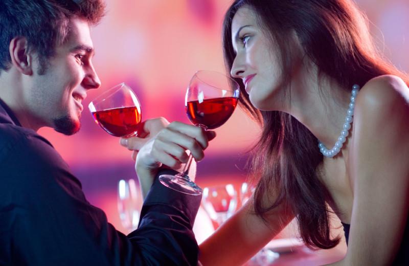 Couple tasting wine at Best Western Plus Stevenson Manor Inn.