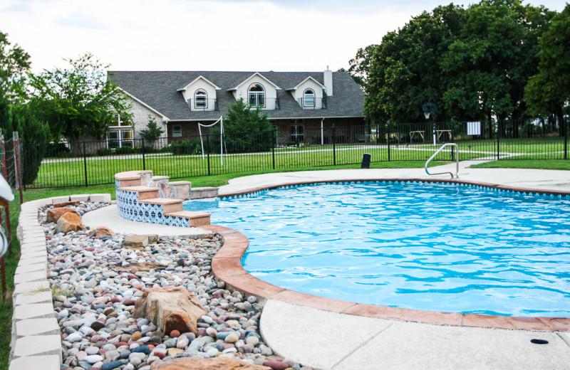 Outdoor pool at MD Resort Bed & Breakfast.