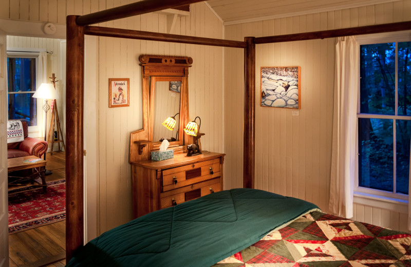 Cabin bedroom at White Pine Camp.
