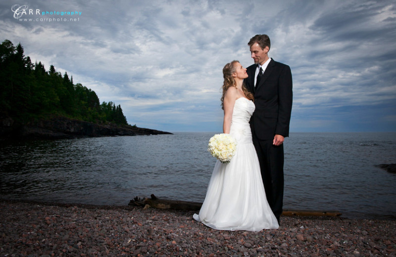 Wedding couple by lake at Bluefin Bay.